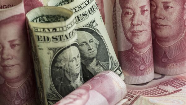 Chinese 100 yuan notes and one US dollar notes in Beijing - Sputnik International