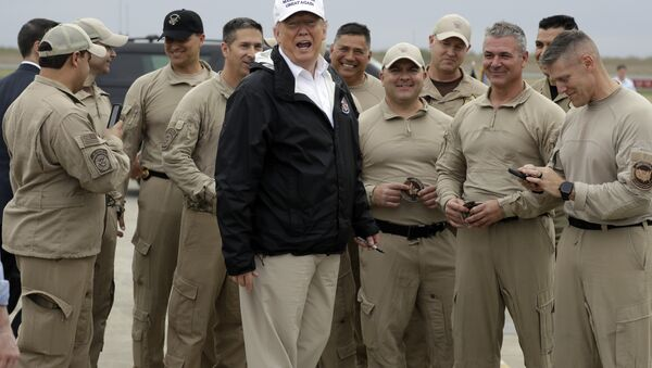 President Donald Trump turns as he talks to U.S. Customs and Border Protection officers at McAllen International Airport as he prepares to leave after a visit to the southern border, Thursday, Jan. 10, 2019, in McAllen, Texas - Sputnik International