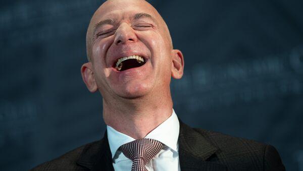 Jeff Bezos, founder and CEO of Amazon, laughs as he speaks during the Economic Club of Washington's Milestone Celebration event in Washington, DC, on September 13, 2018 - Sputnik International