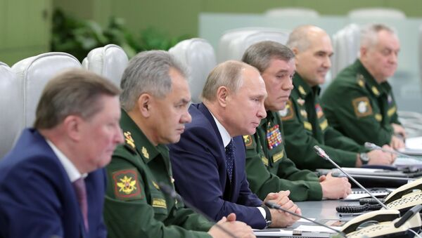 December 26, 2018. Russian President Vladimir Putin watches the launch of the Avangard missile with hypersonic gliding cruise bloc at the National Defense Control Center via a video conference. - Sputnik International