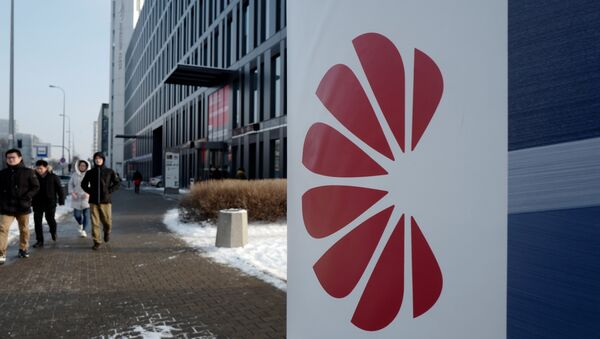 Logo of Huawei is seen on the advert in front of the local offices of Huawei in Warsaw, Poland January 11, 2019 - Sputnik International