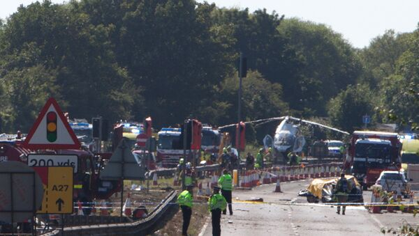 The remains of Andrew Hill's Hawker Hunter strewn over the main A27 road at Shoreham after the August 2015 crash - Sputnik International