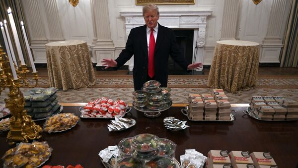 President Donald Trump talks to the media about the table full of fast food in the State Dining Room of the White House in Washington, Monday, Jan. 14, 2019, for the reception for the Clemson Tigers. - Sputnik International