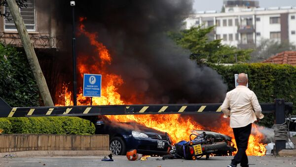 Cars are seen on fire at the scene where explosions and gunshots were heard at the Dusit hotel compound, in Nairobi, Kenya January 15, 2019 - Sputnik International