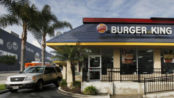 FILE - In this Thursday, April 25, 2013, file photo, a car stops at the drive-thru at a Burger King restaurant near downtown Los Angeles. Restaurant Brands International, the parent company of Burger King and Tim Hortons, reports financial results Monday, Oct. 24, 2016. - Sputnik International