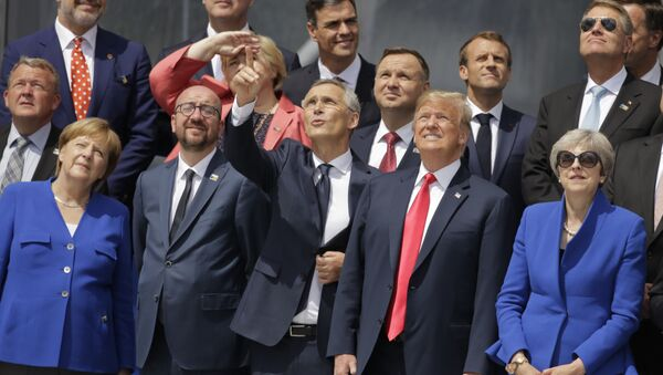 German Chancellor Angela Merkel, Belgian Prime Minister Charles Michel, NATO Secretary-General Jens Stoltenberg, U.S. President Donald Trump and British Prime Minister Theresa May, front row from left, watch a fly-by during a summit of heads of state and government at NATO headquarters in Brussels Wednesday, July 11, 2018. NATO leaders gather in Brussels for a two-day summit to discuss Russia, Iraq and their mission in Afghanistan. - Sputnik International