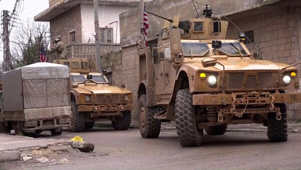 An image grab taken from a video obtained by AFPTV on January 16, 2019, shows US armoured vehicles at the scene of a suicide attack in the northern Syrian town of Manbij - Sputnik International