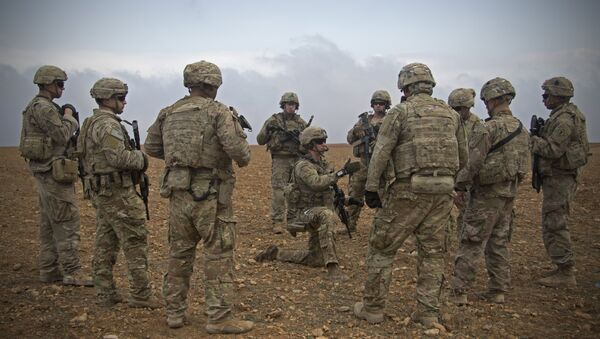 In this Nov. 7, 2018, photo released by the U.S. Army, U.S. soldiers gather for a brief during a combined joint patrol rehearsal in Manbij, Syria - Sputnik International