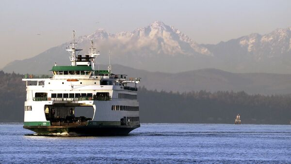 The Washington state ferry Tacoma crosses the Puget Sound in view of the Olympic mountains behind Thursday morning, Dec. 6, 2018, in Seattle.  - Sputnik International