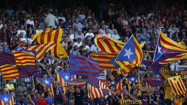 Barcelona fans cheer for their team before the group B Champions League soccer match between FC Barcelona and PSV Eindhoven at the Camp Nou stadium in Barcelona, Spain, Tuesday, Sept. 18, 2018 - Sputnik International