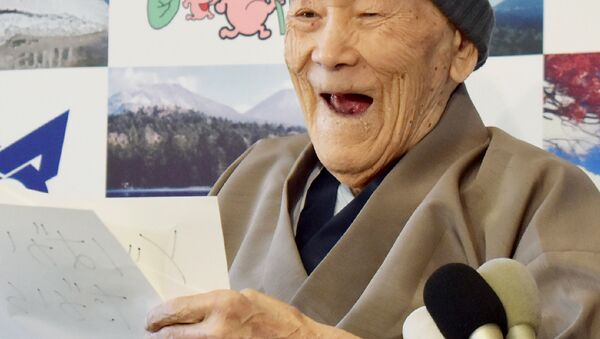 Masazo Nonaka of Japan, aged 112, smiles after being awarded the Guinness World Records' oldest male person living title in Ashoro, Hokkaido prefecture on April 10, 2018. Nonaka was born on July 25, 1905. - Sputnik International