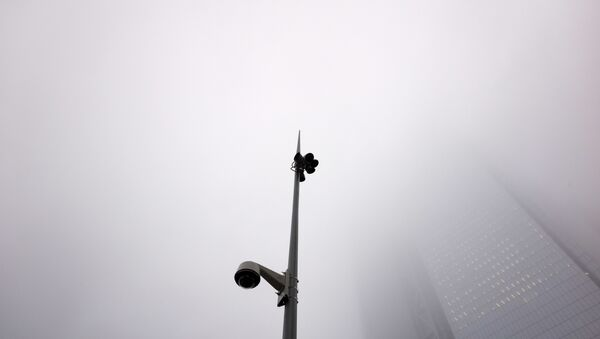 A fog hangs above a light pole with a surveillance camera at the World Trade Center, Tuesday, Feb. 20, 2018, in New York - Sputnik International