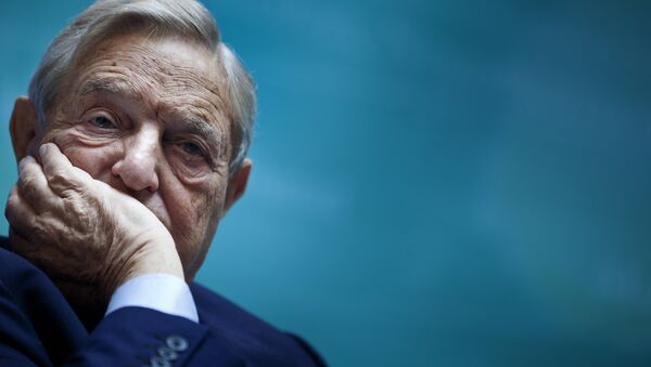George Soros, Chairman of Soros Fund Management, listens during a seminar titled Charting A New Growth Path for the Euro Zone at the annual International Monetary Fund and World Bank meetings September 24, 2011 in Washington, DC. - Sputnik International