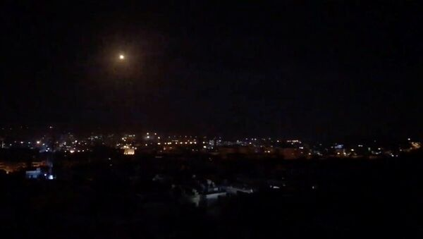 What is believed to be guided missiles are seen in the sky during what is reported to be an attack in Damascus, Syria, January 21, 2019, in this still image taken from a video obtained from social media - Sputnik International