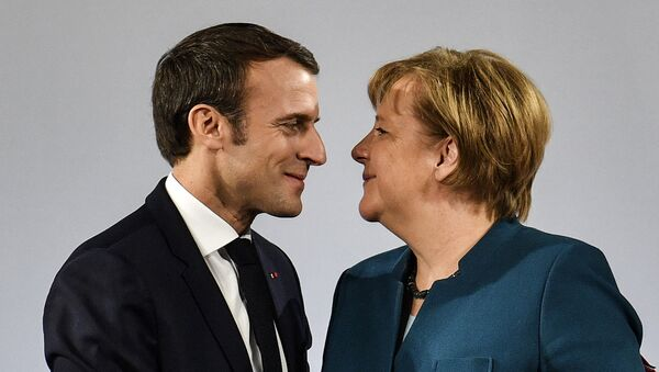 German Chancellor Angela Merkel watches French President Emmanuel Macron after the signing of a new Germany-France friendship treaty at the historic Town Hall in Aachen, Germany, Tuesday, Jan. 22, 2019 - Sputnik International