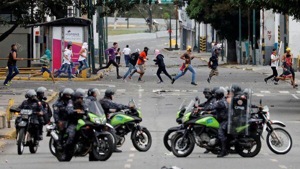 Police secure the area during a protest against Venezuelan President Nicolas Maduro's government in Caracas, Venezuela January 23, 2019. - Sputnik International