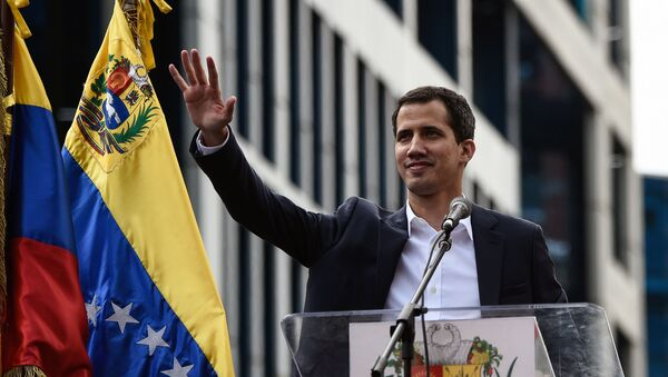 Venezuela's National Assembly head Juan Guaido waves to the crowd during a mass opposition rally against leader Nicolas Maduro in which he declared himself the country's acting president, on the anniversary of a 1958 uprising that overthrew military dictatorship, in Caracas on January 23, 2019. - Sputnik International
