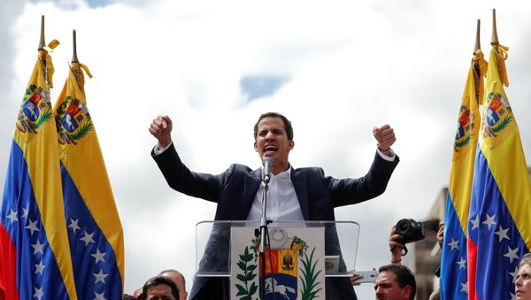 Juan Guaido, President of Venezuela's National Assembly, reacts during a rally against Venezuelan President Nicolas Maduro's government and to commemorate the 61st anniversary of the end of the dictatorship of Marcos Perez Jimenez in Caracas, Venezuela January 23, 2019 - Sputnik International
