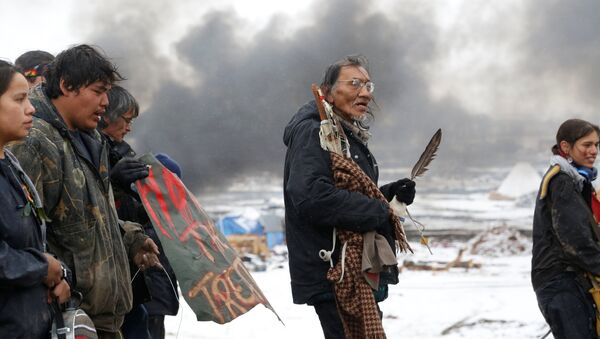 Nathan Phillips (C) marches with other protesters out of the main opposition camp against the Dakota Access oil pipeline near Cannon Ball, North Dakota, U.S., February 22, 2017. Picture taken February 22, 2017 - Sputnik International