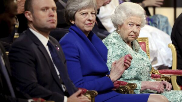 Britain's Queen Elizabeth II, Britain's Prime Minister Theresa May, center, and Prime Minister of Malta Joseph Muscat, left, attend the formal opening of the Commonwealth Heads of Government Meeting in the ballroom at Buckingham Palace in London, Thursday April 19, 2018. - Sputnik International