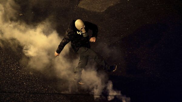 A protester kick back a tear gas canister fired by riot police during clashes following a rally by opponents of Prespa Agreement, outside the Greek Parliament in Athens, Thursday, Jan. 24, 2019 - Sputnik International