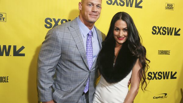 John Cena and his fiancé, Nikki Bella, arrive for the world premiere of Blockers during the South by Southwest Film Festival at the Paramount Theatre on Saturday, March 10, 2018, in Austin, Texas - Sputnik International