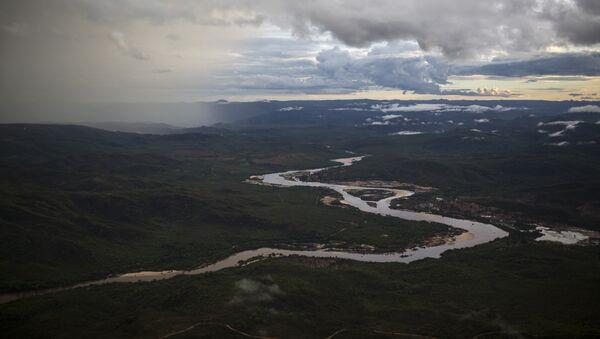 In this Nov. 18, 2015 photo, the Jequitinhonha River snakes across the landscape near Areinha, Minas Gerais state, Brazil. - Sputnik International