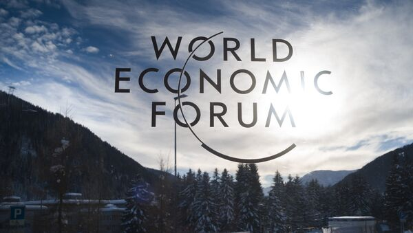 The sign of the World Economic Forum, WEF, is displayed at an entrance door at the congress center at the eve of the meeting in Davos, Sunday, Jan. 20, 2019. - Sputnik International