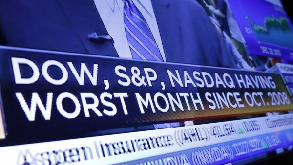 A headline on a television screen on the floor of the New York Stock Exchange - Sputnik International