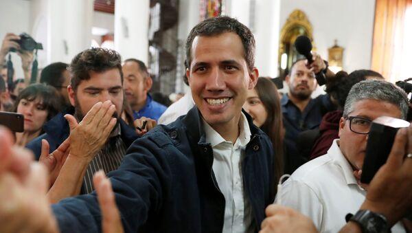 Venezuelan opposition leader and self-proclaimed interim president Juan Guaido arrives to attend a holy mass in Caracas, Venezuela, January 27, 2019 - Sputnik International