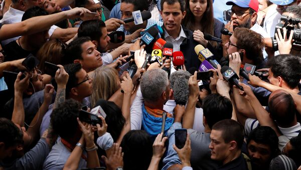 Venezuelan opposition leader and self-proclaimed interim president Juan Guaido accompanied by his wife Fabiana Rosales, speaks to the media after a holy Mass at a local church in Caracas, Venezuela, January 27, 2019 - Sputnik International