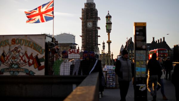 A Union flag flies from a pole in front of the Elizabeth Tower, commonly known as Big Ben, near the Houses of Parliamnet in central London on January 28, 2019 - Sputnik International