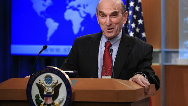 Elliott Abrams talks to reporters after Secretary of State Mike Pompeo named the hawkish former Republican official to handle U.S. policy toward Venezuela during a news conference at the State Department in Washington, Friday, Jan. 25, 2019 - Sputnik International