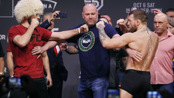 Conor McGregor, right, and Khabib Nurmagomedov face off during a ceremonial weigh-in - Sputnik International