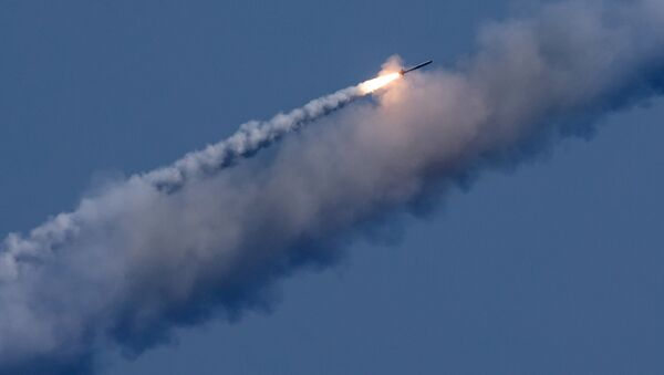 The Russian submarines Kolpino and Veliky Novgorod launch seven Kalibr cruise missiles at terrorist targets in Syria - Sputnik International