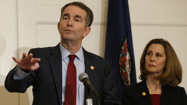 Virginia Gov. Ralph Northam, left, gestures as his wife, Pam, listens during a news conference in the Governors Mansion at the Capitol in Richmond, Va., Saturday, Feb. 2, 2019 - Sputnik International