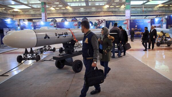 Visitors look at a Hoveizeh 8 cruise missile at a military show marking the 40th anniversary of Iran's Islamic Revolution. - Sputnik International