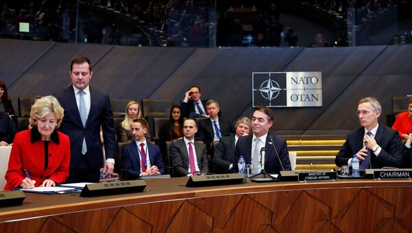 US Ambassador to NATO Kay Bailey Hutchison, Macedonian Foreign Minister Nikola Dimitrov and NATO Secretary General Jens Stoltenberg attend a signature ceremony of the accession protocol between the Republic of North Macedonia and NATO at the Alliance headquarters in Brussels, Belgium February 6, 2019. - Sputnik International
