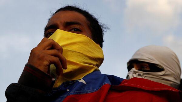 Demonstrators are seen during a protest against Venezuelan President Nicolas Maduro's government in Caracas, Venezuela February 2, 2019 - Sputnik International
