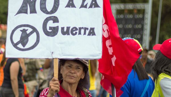 A woman takes part in a rally in support of the Venezuelan President Nicolas Maduro, in Caracas, Venezuela. - Sputnik International