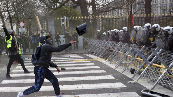 A protestor throws an object at a police line during a demonstration in Brussels, Saturday, Dec. 8, 2018. - Sputnik International