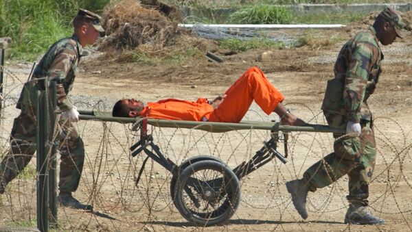 a detainee from Afghanistan is carried on a stretcher before being interrogated by military officials at the detention facility Camp X-Ray on Guantanamo Bay U.S. Naval Base in Cuba - Sputnik International