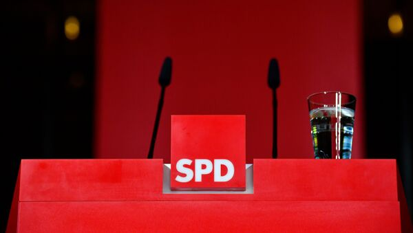 The pulpit is empty after the leader of Germany's social democratic SPD party (unseen) gave a statement in reaction to the results of the state elections in Hesse (Hessen) at the SPD headquarters in Berlin, on October 28, 2018.  Tobias SCHWARZ / AFP - Sputnik International