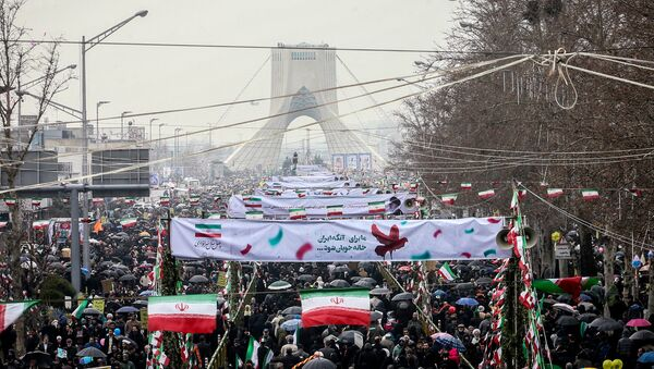 Iranian people gather during a ceremony to mark the 40th anniversary of the Islamic Revolution in Tehran, Iran February 11, 2019 - Sputnik International