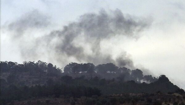Smoke rises from inside Syria during shelling from Turkish forces, as seen from the Oncupinar border crossing with Syria, known as Bab al Salameh in Arabic, in the outskirts of the town of Kilis, Turkey, Friday, Jan. 26, 2018 - Sputnik International