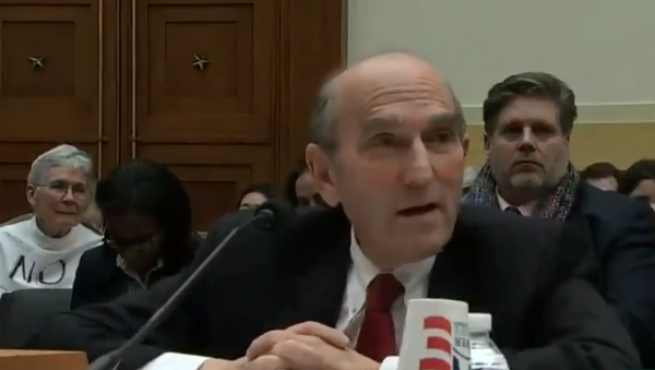 Elliot Abrams, the US special envoy to Venezuela, speaks with Minnesota Congresswoman Ilhan Oman during a House Foreign Affairs Committee hearing - Sputnik International
