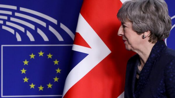 British Prime Minister Theresa May looks on at the EU parliament headquarters in Brussels, Belgium February 7, 2019. - Sputnik International