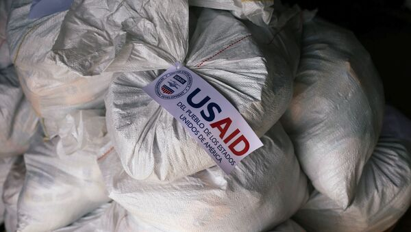 Sacks containing humanitarian aid are pictured at a warehouse near the Tienditas cross-border bridge between Colombia and Venezuela - Sputnik International