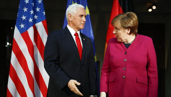 German Chancellor Angela Merkel, right, welcomes United States Vice President Mike Pence, left, for a bilateral meeting during the Munich Security Conference in Munich, Germany, Saturday, Feb. 16, 2019 - Sputnik International