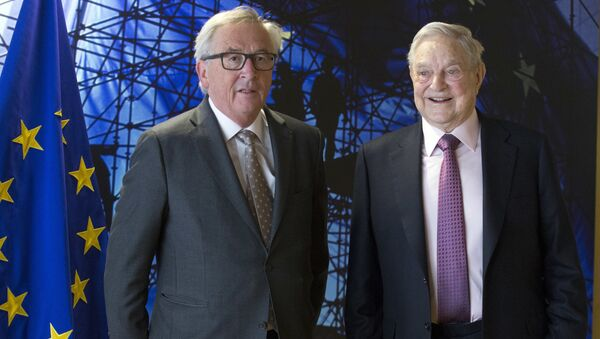 EU commission President Jean-Claude Juncker, left, welcomes George Soros, Founder and Chairman of the Open Society Foundation, prior to a meeting at EU headquarters in Brussels on Thursday, April 27, 2017 - Sputnik International